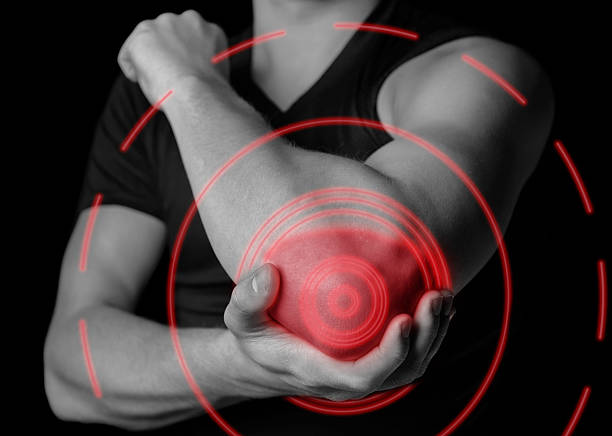 Pain in the elbow joint, painful area of red color stock photo