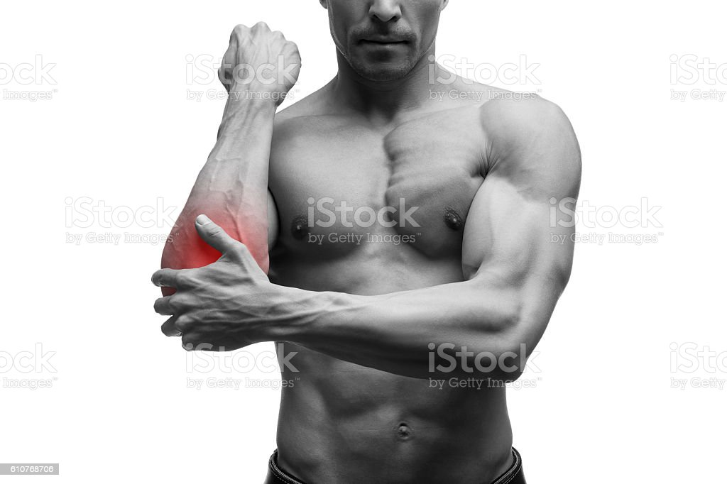 Pain in the elbow, muscular male body, isolated stock photo