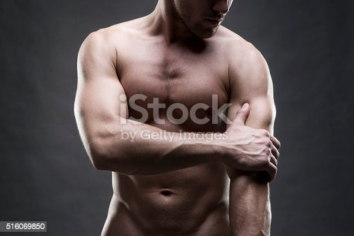istock Pain in the elbow on gray background 516069850