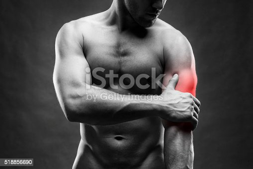 578088054istockphoto Pain in the elbow on gray background 518856690