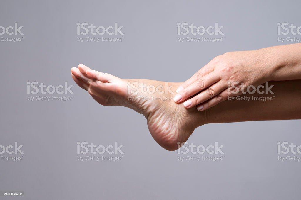 Pain in the foot. Massage of female feet stock photo