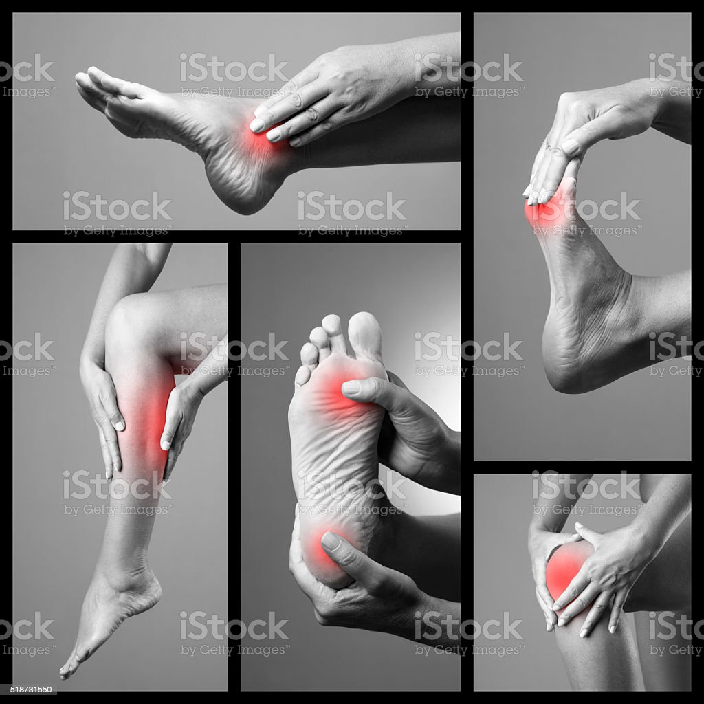 Pain in the foot on a gray background stock photo