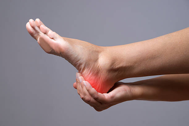 pain in the foot - human foot stock photos and pictures