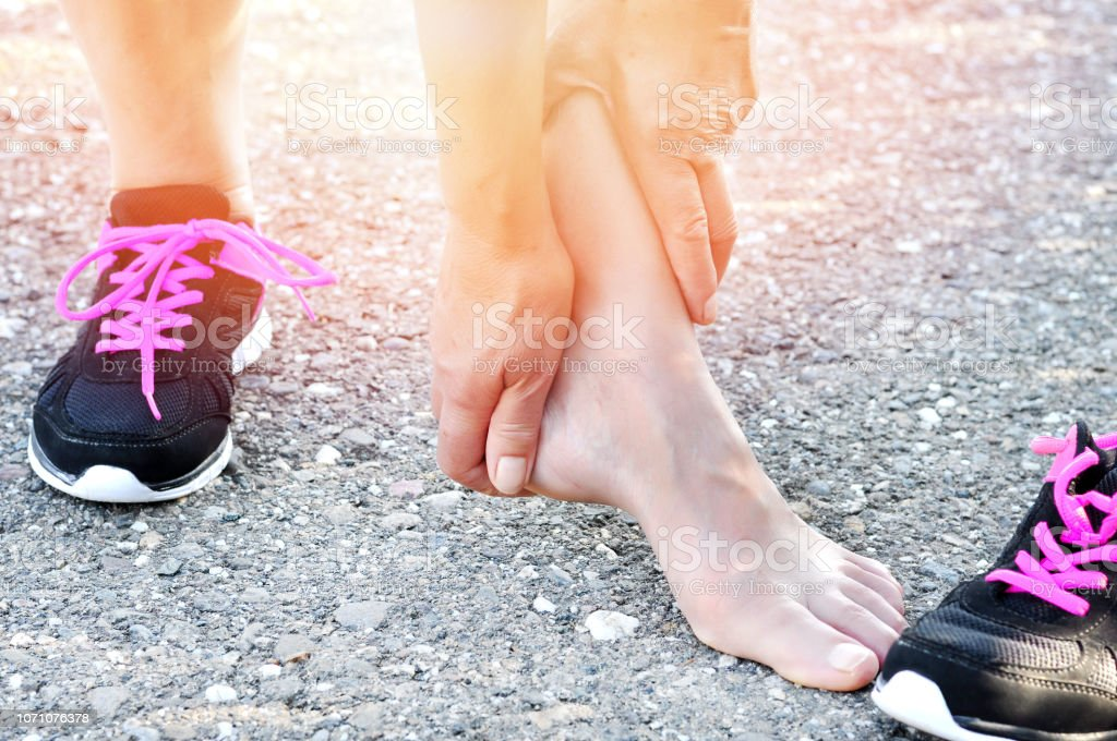 Pain in the foot.Running injury leg accident- sport woman runner...