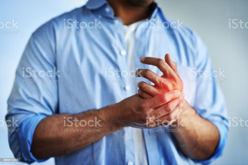 Pain in the hands can be symptoms of carpal tunnel syndrome stock photo
