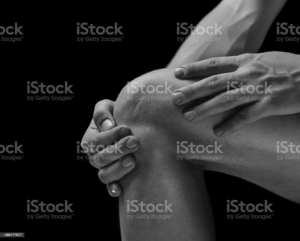 Pain in the knee joint stock photo