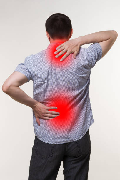 Pain in the male body, man with backache, sciatica and scoliosis, chiropractor treatment concept stock photo