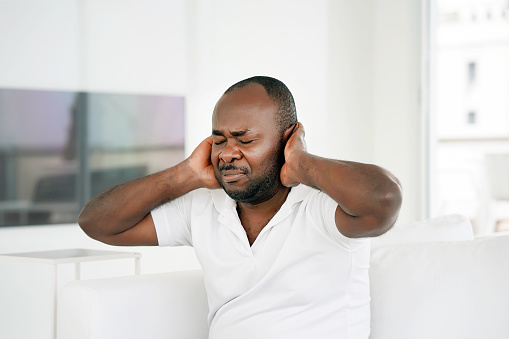 istock Pain in the neck of a man from fatigue. Tired neck. 1134509314