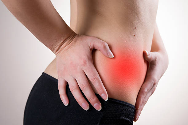 Pain in the right side of the woman stock photo