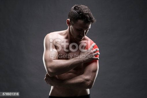 578088054istockphoto Pain in the shoulder. Muscular male body 576931316