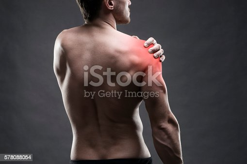 istock Pain in the shoulder. Muscular male body. 578088054