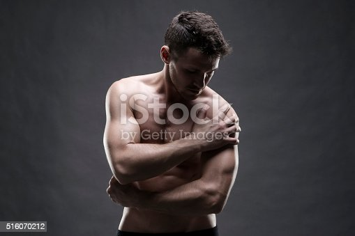 istock Pain in the shoulder on gray background 516070212