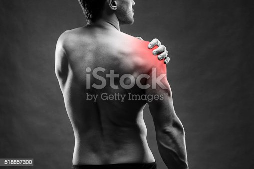 istock Pain in the shoulder on gray background 518857300