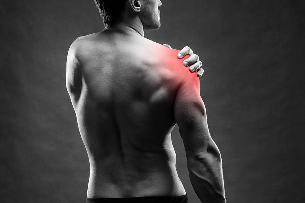 pain in the shoulder on gray background - inflammation bildbanksfoton och bilder