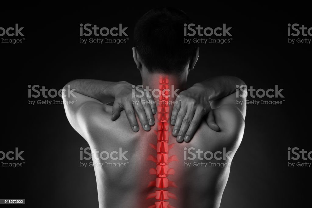 Pain in the spine, a man with backache, injury in the human back and...