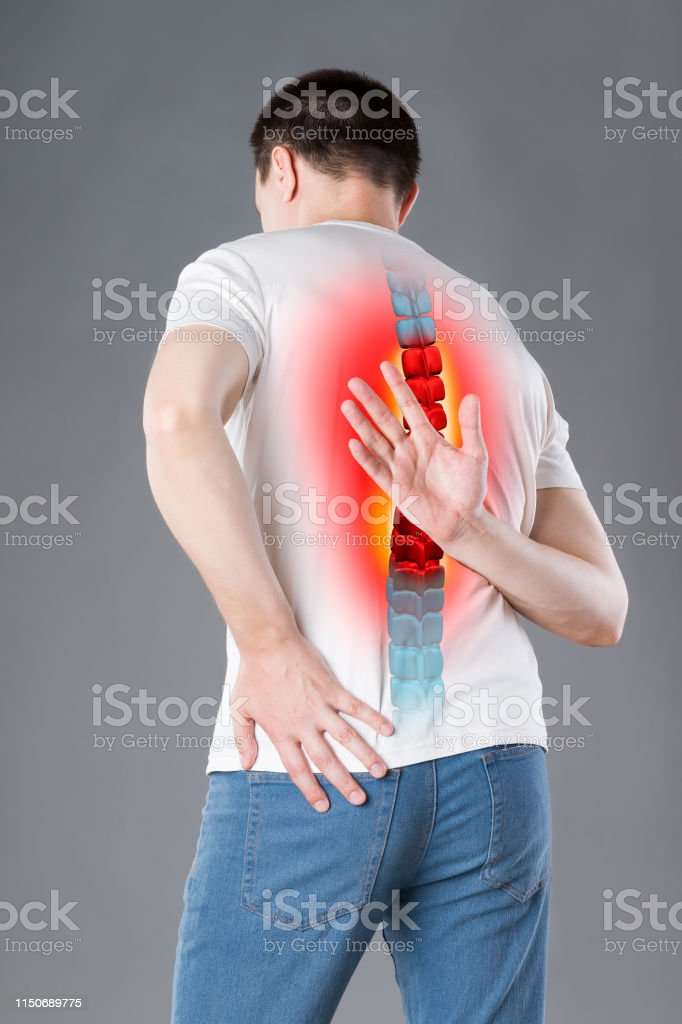 Pain in the spine, a man with backache, injury in the human back,...