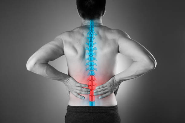 Pain in the spine, a man with backache, injury in the lower back stock photo