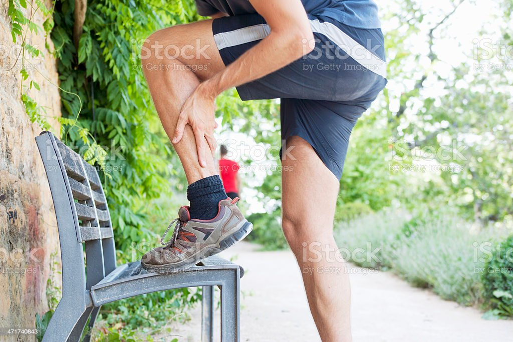 Pain in upper achilles tendon stock photo