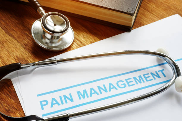 Pain management documents and stethoscope with book. stock photo