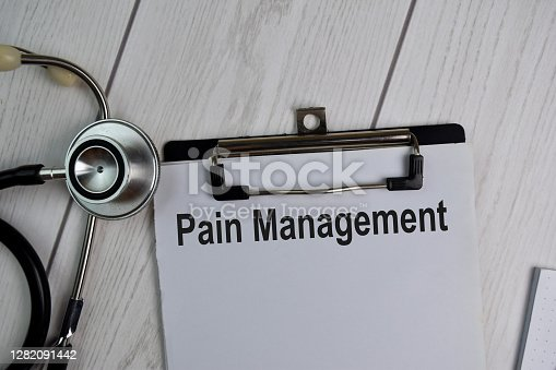 Pain Management text write on a paperwork isolated on office desk. Healthcare/Medical concept