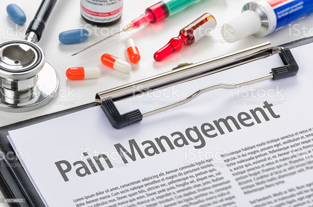 Pain Management written on a clipboard stock photo