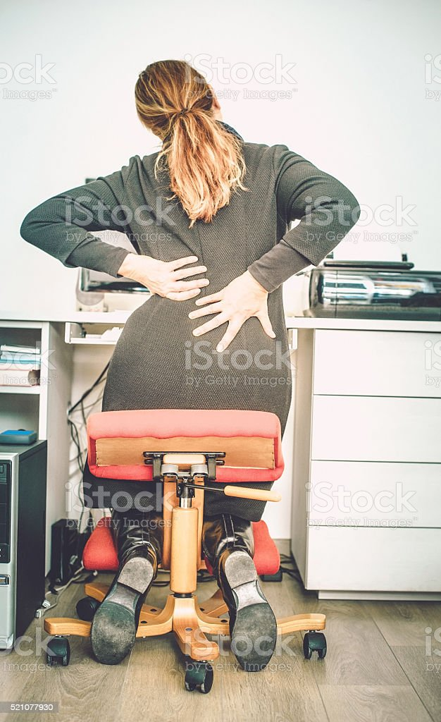 Pain of lower back stock photo
