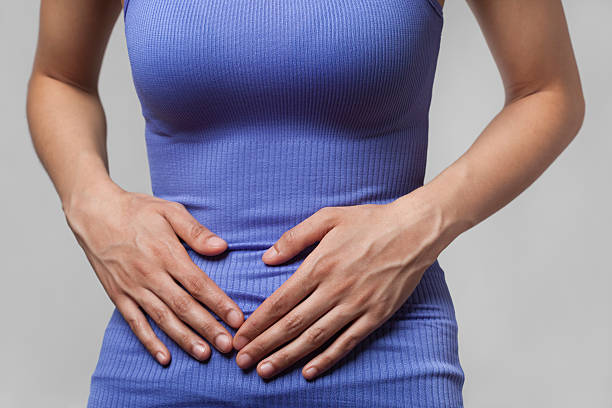 Pain or cramps in stomach stock photo