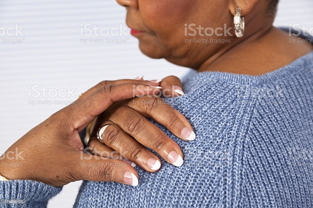 Pain:  Senior African descent woman shoulder in pain stock photo