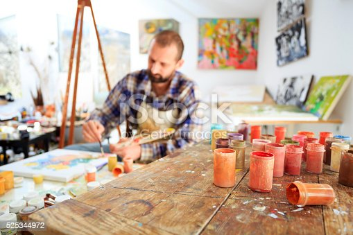 istock Painer drawing in his studio 525344972