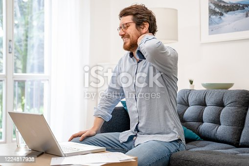 istock Painful guy aching from pain in back or reins at home 1224817938