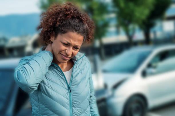 Painful neck ache after fender bender car crash stock photo