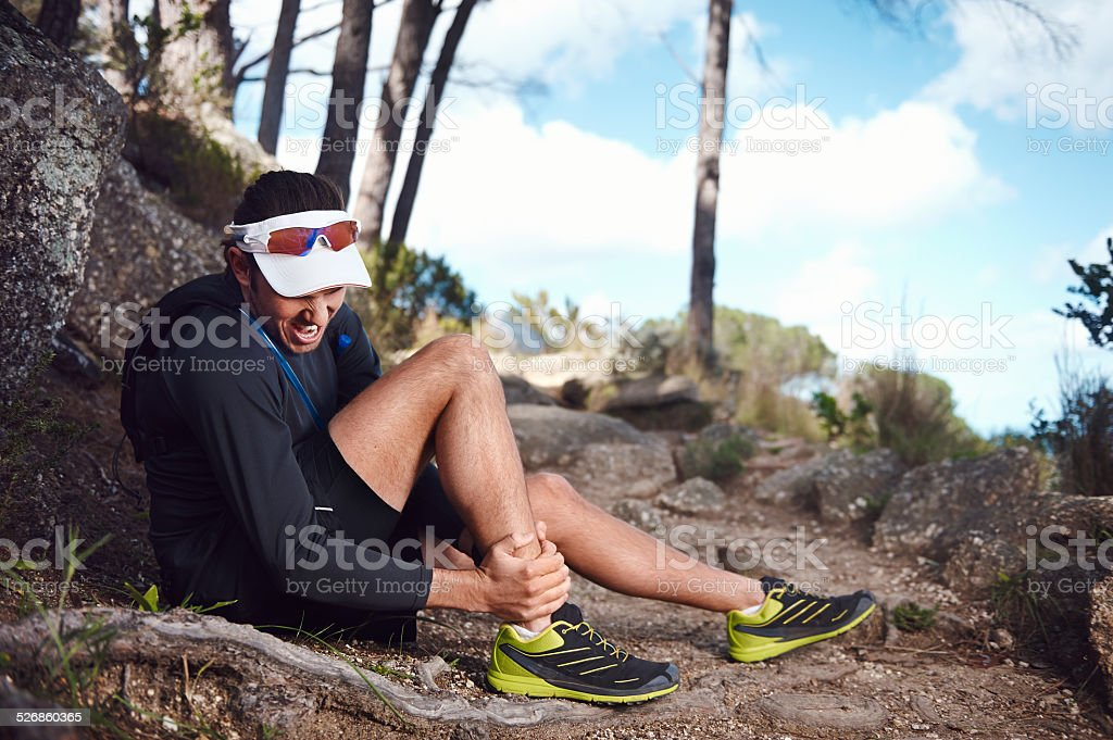 painful running injury stock photo