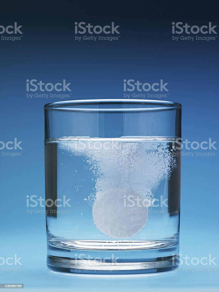 painkiller dissolving in water stock photo