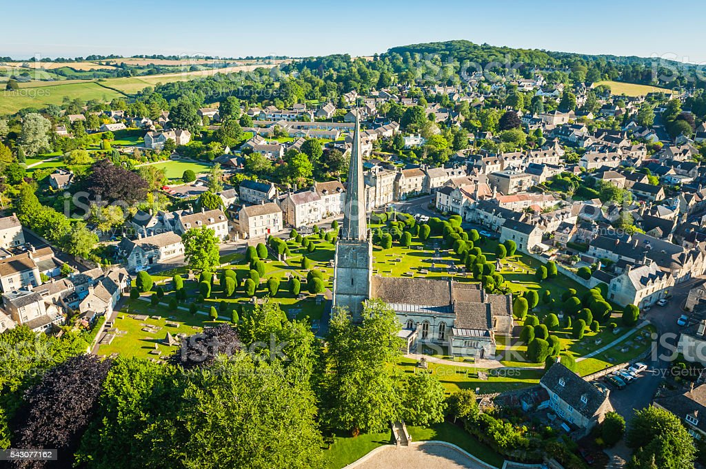 Painswick village church pretty Cotswold country cottages aerial photograph UK stock photo