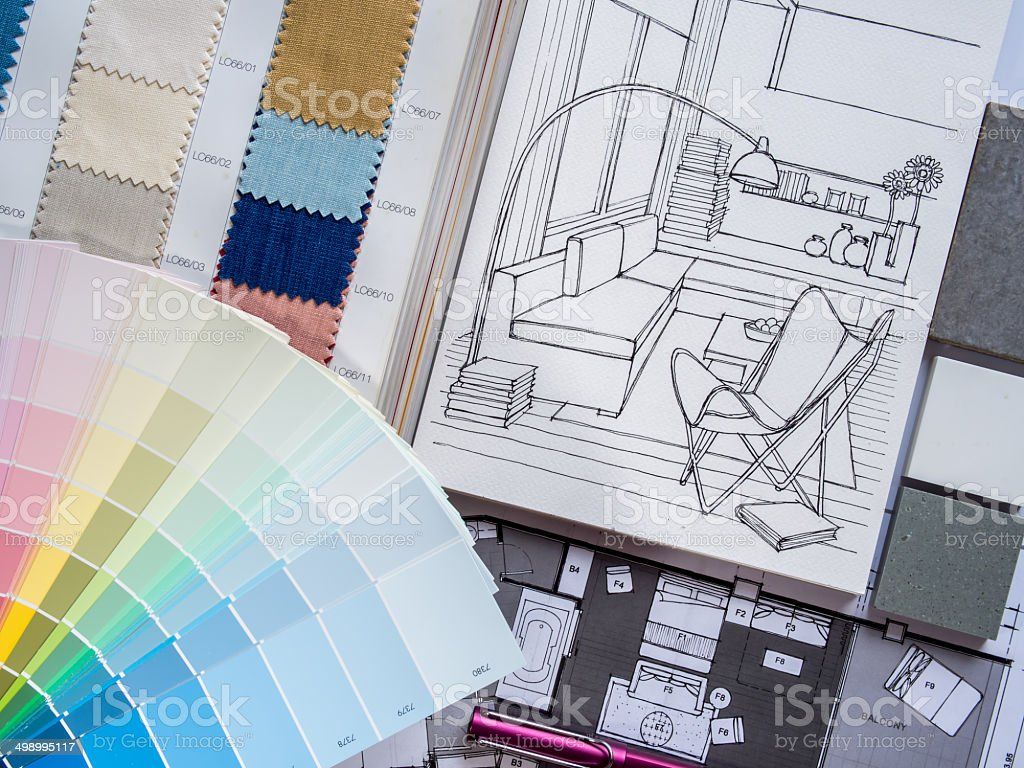 Paint and fabric samples with living room drawings stock photo