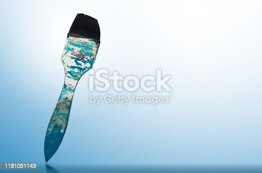 istock paint brush and blue-white gradient background 1181051143