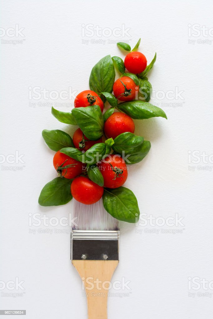Paint brush and dab of ketchup . Food art concept. Top view. Flat lay