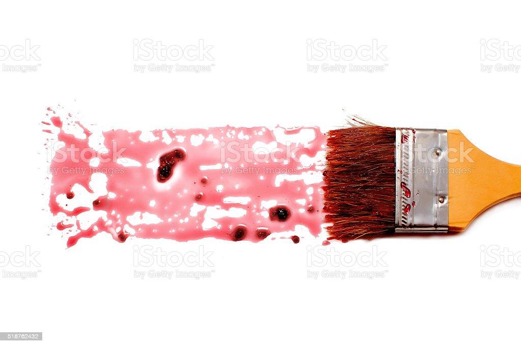 paint brush and dab of raspberry jam stock photo