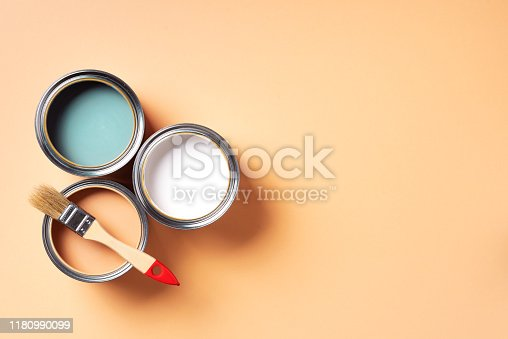 Paint brush and open paint can with on pastel background. Top view, copy space. Appartment renovation, repair, building and home design concept