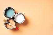 istock Paint brush and open paint can with on pastel background. Top view, copy space. Appartment renovation, repair, building and home design concept. 1180990099