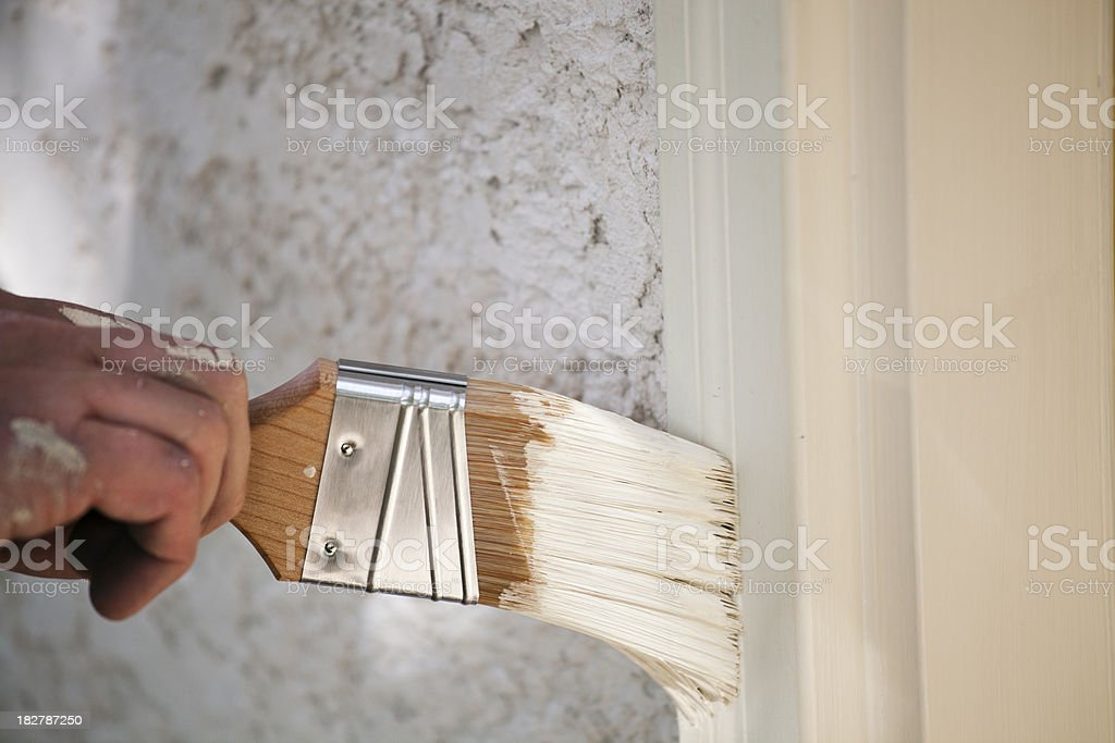 Paint Brush in Motion Painting Wood Window Frame royalty-free stock photo