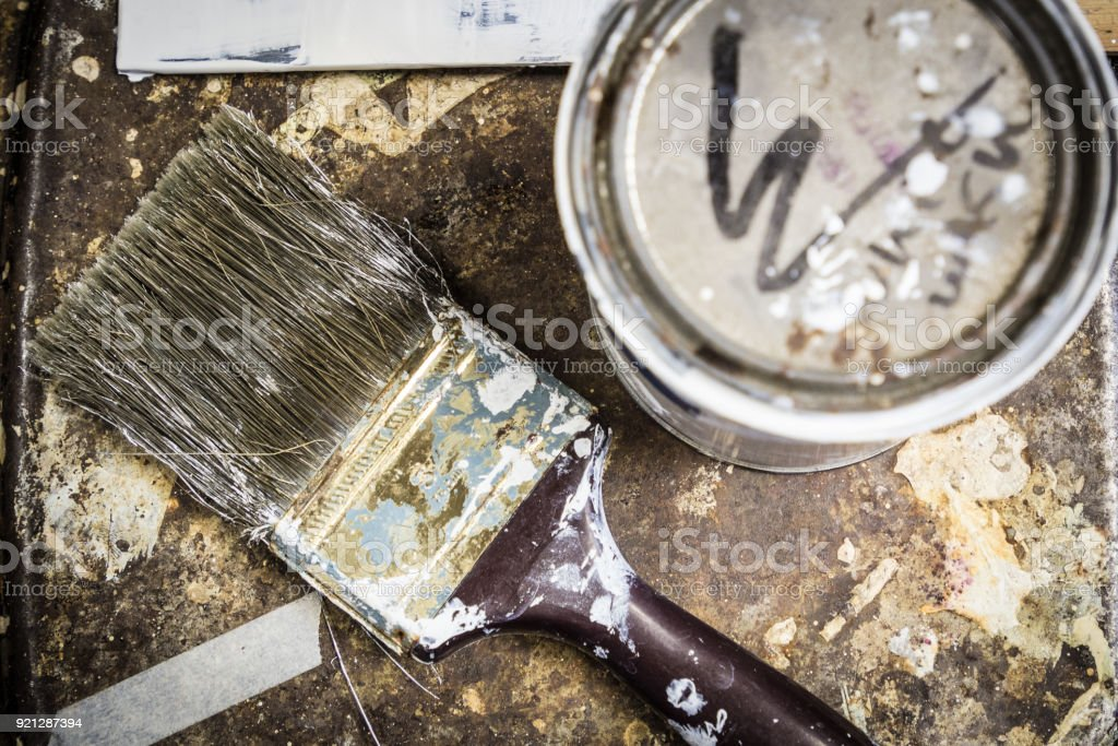 Paint Brush on a rusted metal table stock photo