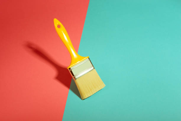 Paint brush on vibrant colorful background stock photo
