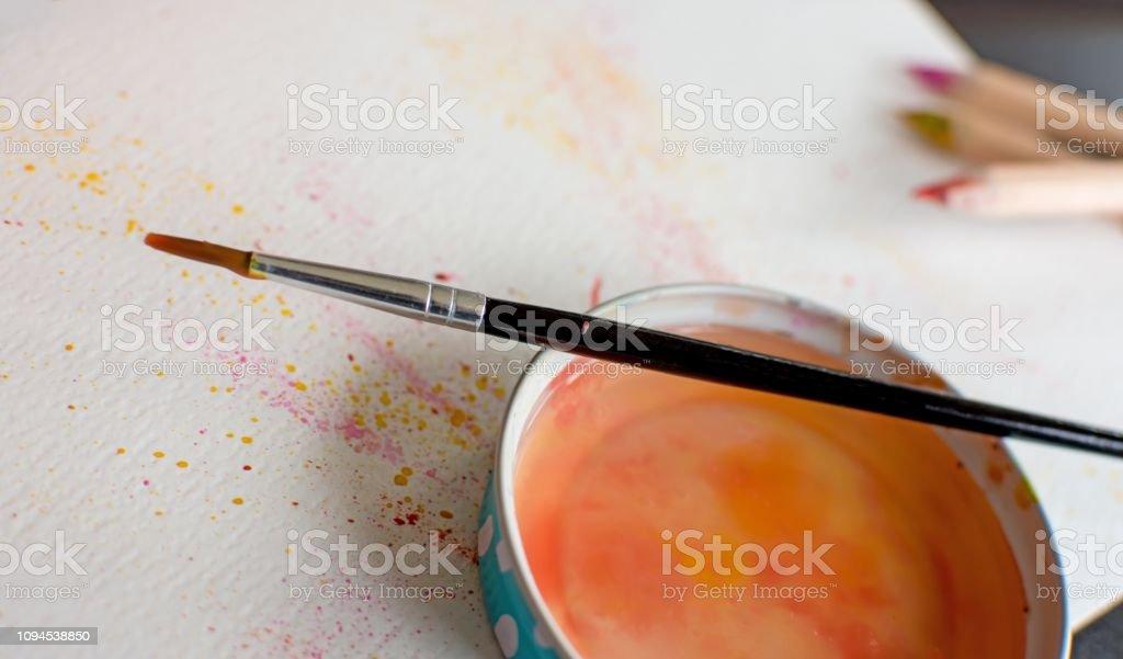 Paint brush over water creativity concept stock photo
