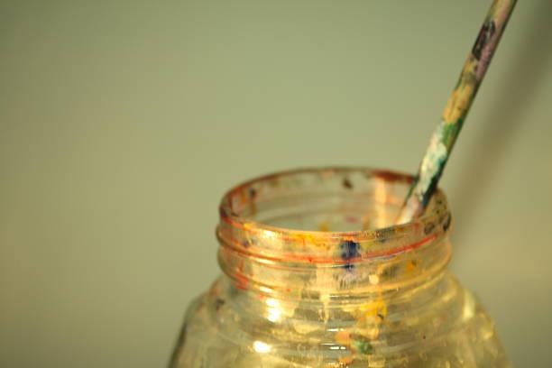 paint brush pot - bemalte tontöpfe stock-fotos und bilder