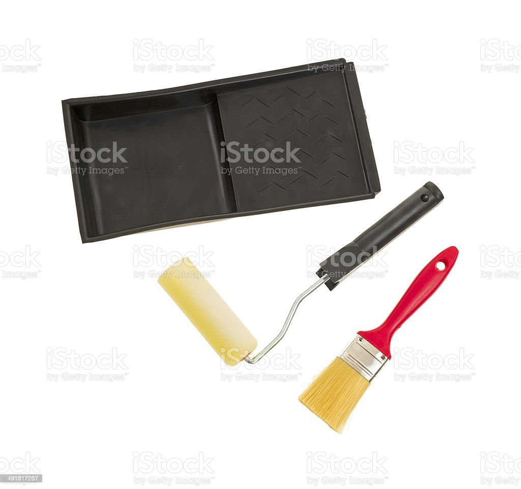 Paint brush, roller and tray stock photo