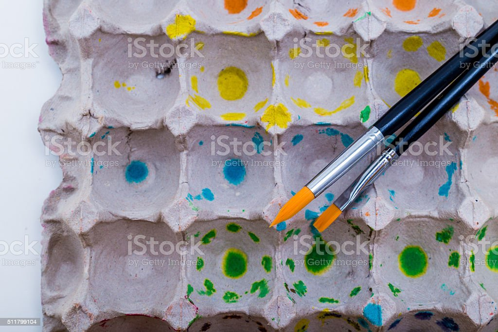 Paint brushes and egg carton stock photo