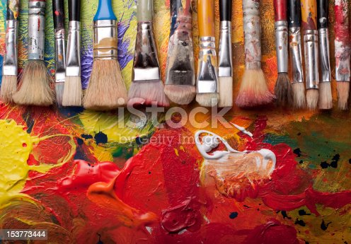 Paint brushes in a row,pallete at background,studio shoot