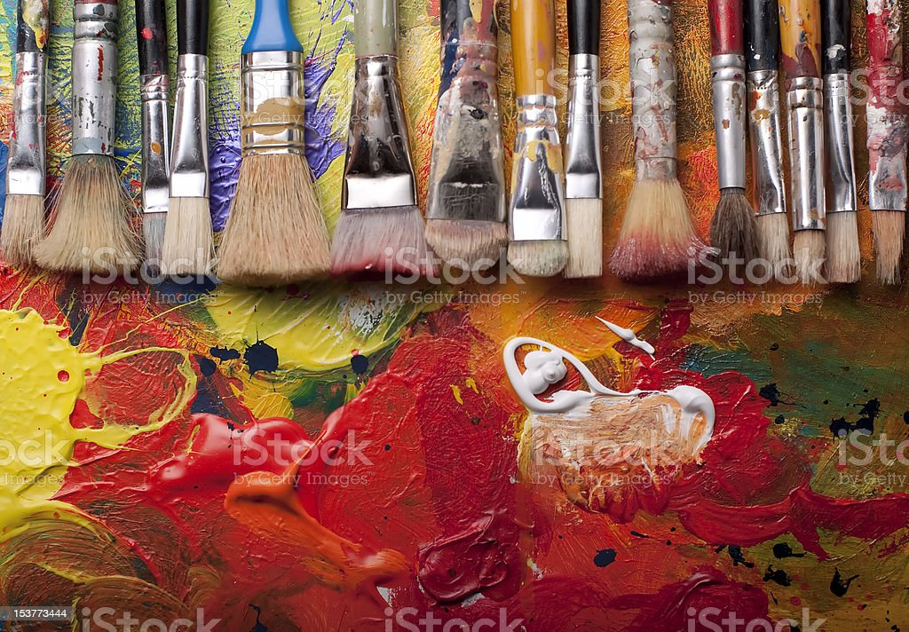 Paint brushes in a row stock photo