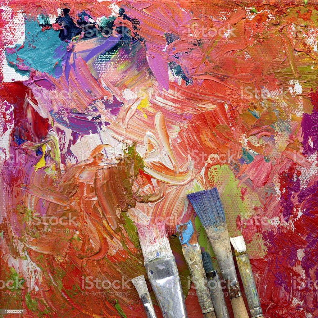 paint brushes lying on artwork stock photo